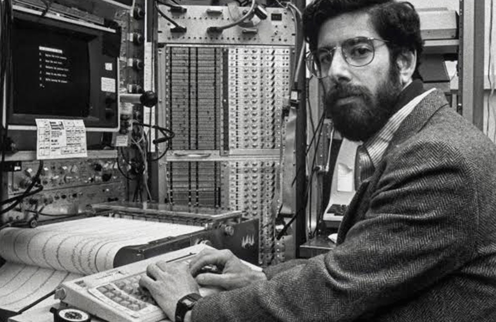 a young Dr. Richard Davidson working on a computer