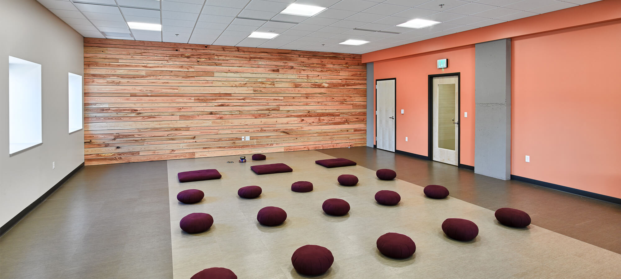 Meditation room with sitting pillows placed in rows across the floor