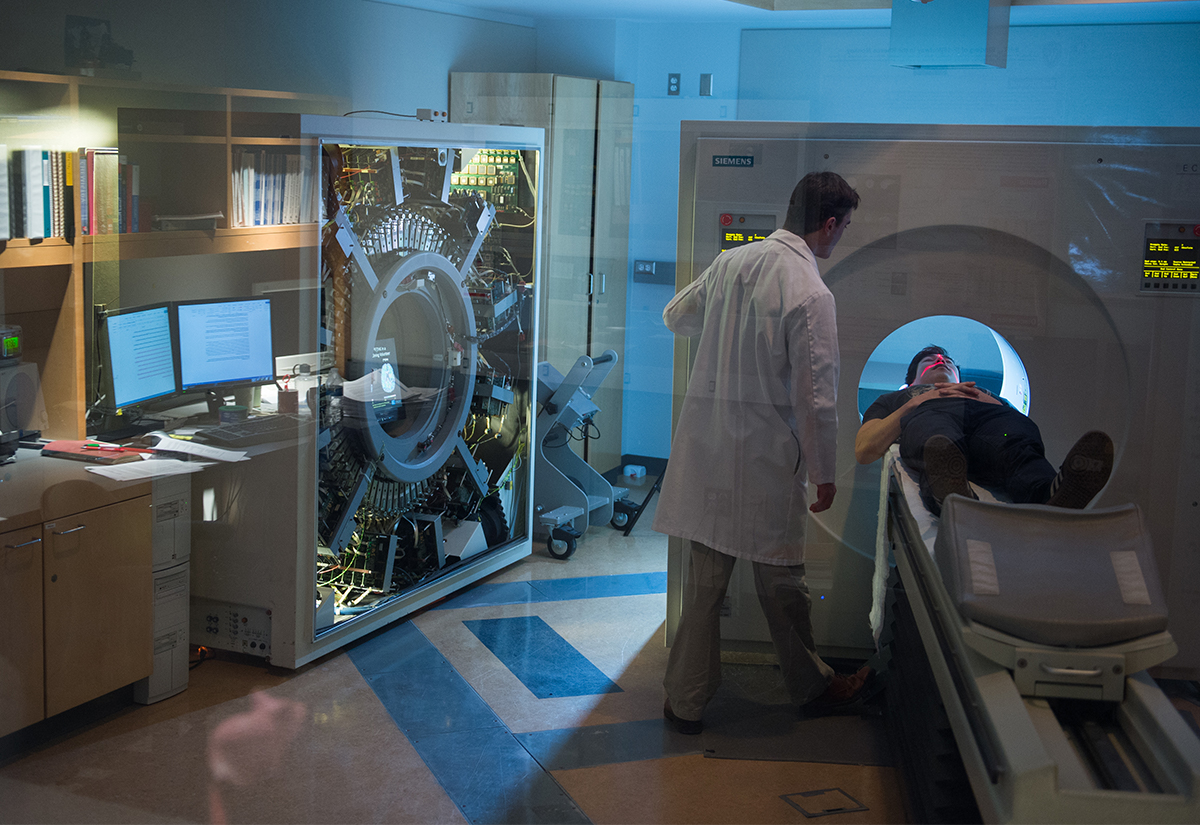Medical professional performing a brain scan